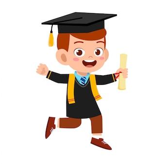 Happy cute little kid boy graduate from school