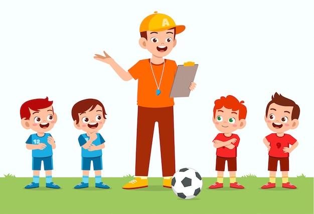Happy cute little kid boy play football with friend