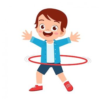 Happy cute little kid boy play hula hoop