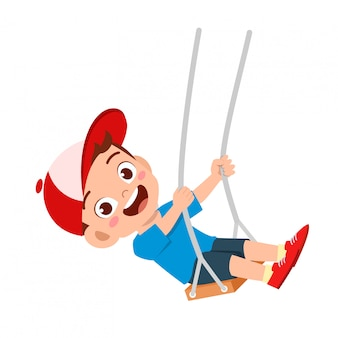 Happy cute little kid boy play swing