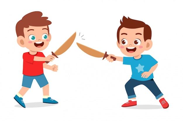 Happy cute little kid boy play wooden sword