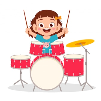 Happy cute little kid boy playing drum