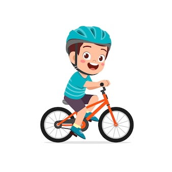 Happy cute little kid boy riding bicycle