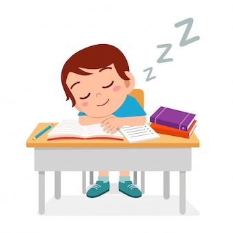 Happy cute little kid boy sleep in class