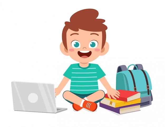 Happy cute little kid boy study using laptop