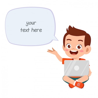 Happy cute little kid boy use laptop