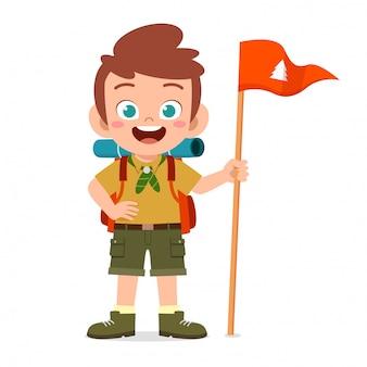 Happy cute little kid boy wear scout uniform