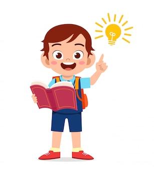 Happy cute little kid boy with light idea