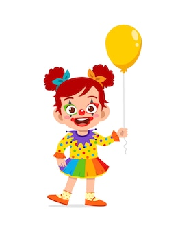 Happy cute little kid celebrate halloween wears clown costume