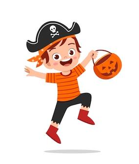 Happy cute little kid celebrate halloween wears pirate costume