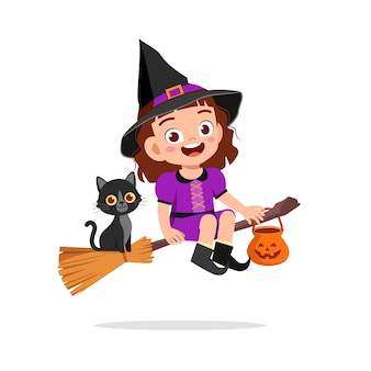 해피 귀여운 꼬마 할로윈을 축하 마녀 의상을 입는다