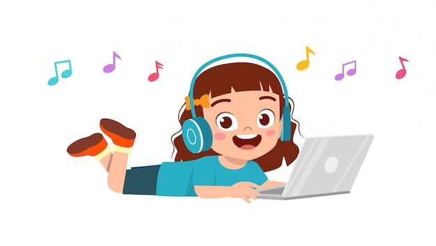 Happy cute little kid girl listening music