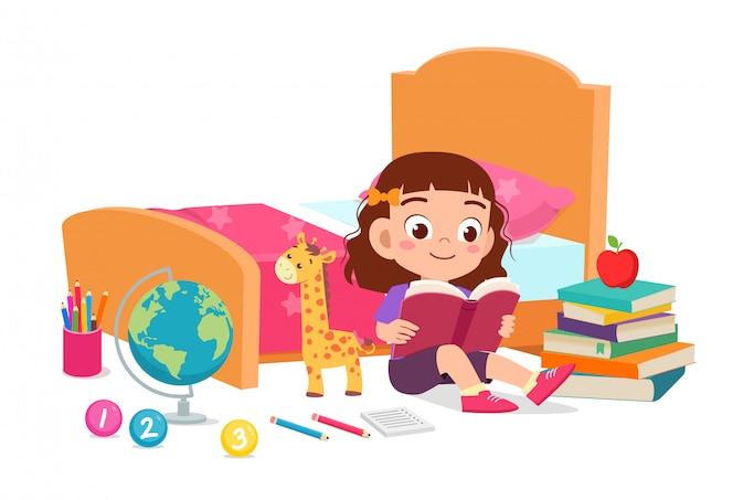 Happy cute little kid girl read book in bed room