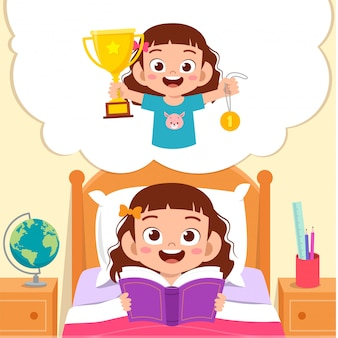 Happy cute little kid girl read book and dreaming