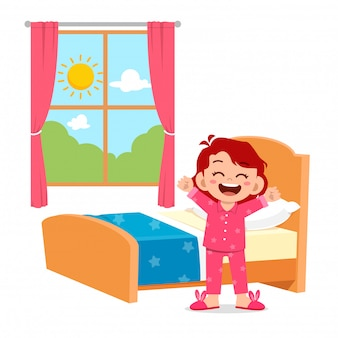 Happy cute little kid girl wake up in the morning
