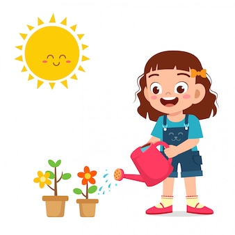 Happy cute little kid girl watering flower
