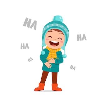 Happy cute little kid play and wear jacket in winter season