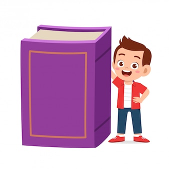 Happy cute little kid with big book