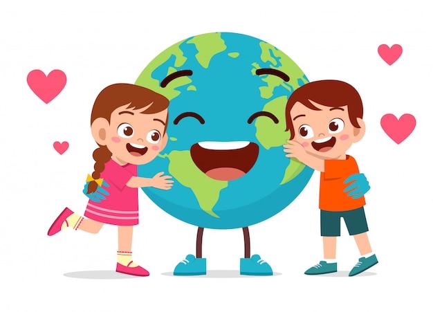 Happy cute little kids boy and girl love earth