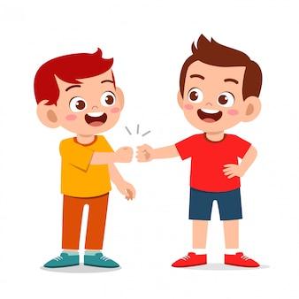Happy cute little kids boys fist bump