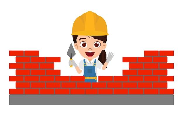 陽気な表情の建物のレンガの壁と建設労働者の衣装を着て幸せなかわいいスマートな子供の女の子のキャラクター