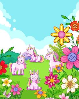 庭で遊んでいる花と幸せなかわいいユニコーン