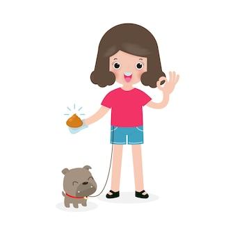 幸せなかわいい若い女の子が犬の後に掃除