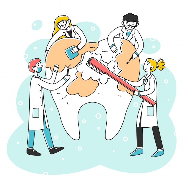 Happy dentists cleaning big tooth