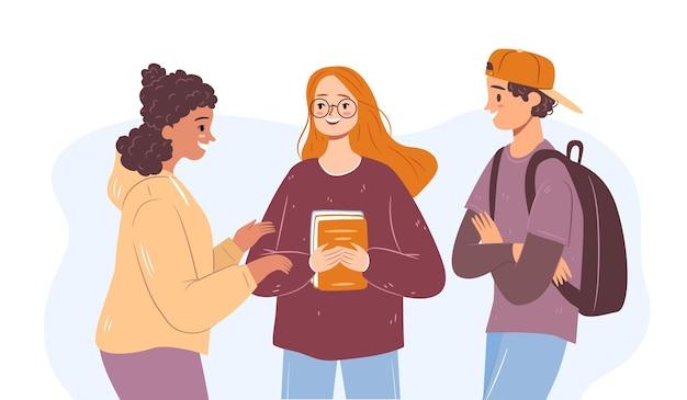 学校の休憩時間に幸せな多様な学生女の子と話している男