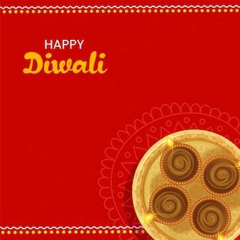 赤い背景に点灯している石油ランプ(ディヤ)の上面図ゴールデンプレートと幸せなディワリ祭のお祝いのコンセプト。