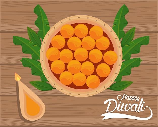 木製の背景にキャンドルと食べ物で幸せなディワリ祭のお祝い