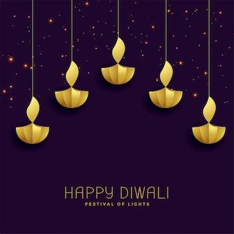 Happy diwali festival greeting with golden diya