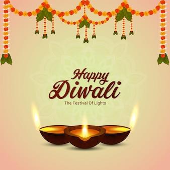Happy diwali festival of light celebration greeting card with garland flower and diwali diya