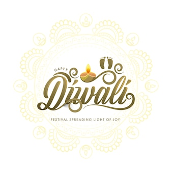 Happy diwali font with goddess footprint and lit oil lamp
