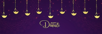 Happy diwali golden diya and purple background