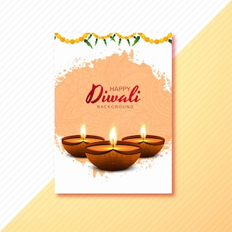 Happy diwali greeting card decorated with candles and flowers