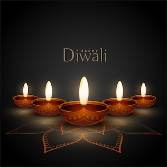 Happy diwali greeting card with realistic diya design