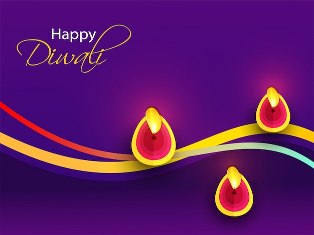 Happy diwali greeting card  with top view of illuminated oil lamp (diya) decorated on purple .