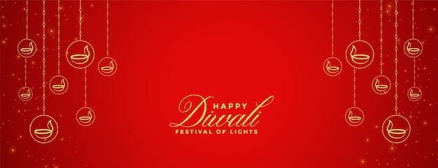 Diyaの装飾が施された幸せなディワリの赤いバナー