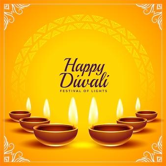 Cartellino giallo felice di diwali con diya realistico Vettore gratuito