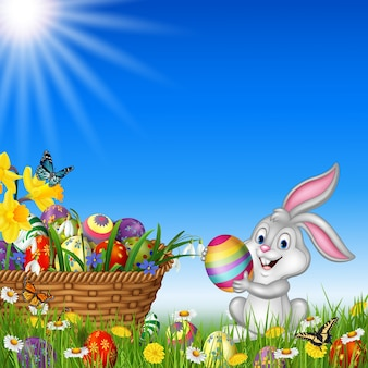 Happy easter background with rabbit holding an easter egg