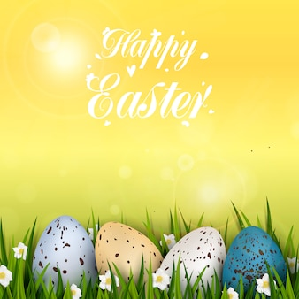 リアルなカラフルな装飾が施されたウズラの卵、草、花とハッピーイースターの背景