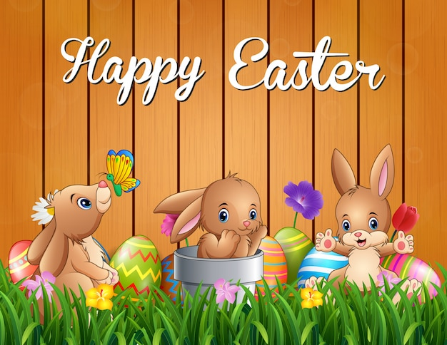 Happy easter bunnies on a background fence