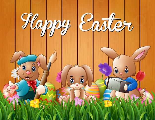 Happy easter bunnies on a background fence Premium Vector