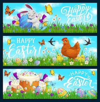 幸せなイースターバニー、ひよこ、飾られた卵とケーキと鶏