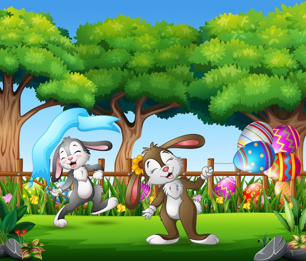 Happy easter bunny on the nature background