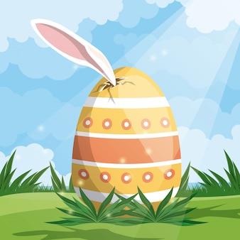 耳のウサギで描かれた卵のハッピーイースターカード