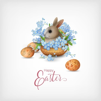 Happy easter card with a basket full of spring flowers, painted eggs and cute little rabbit