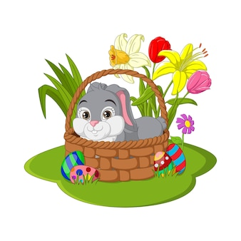 Happy easter. cute easter bunny sitting in a basket