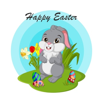 Happy easter. cute easter bunny with eggs in the grass